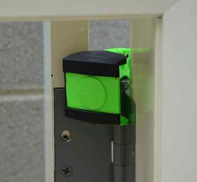 Green Wedge It Door Stop