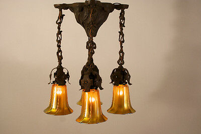 Early 1900's cast iron four light fixture with signed Quezal shades