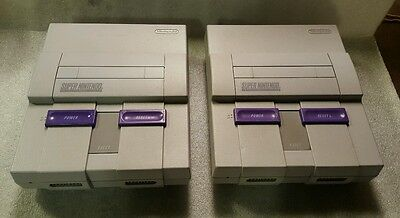 2 Super Nintendo Game Systems Sold For Parts Or Repair Both Power Up.