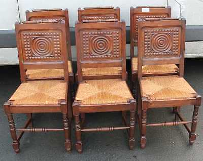 Set 6 Breton Carved Oak Dining Chairs with pop out Rush seats. 1920's