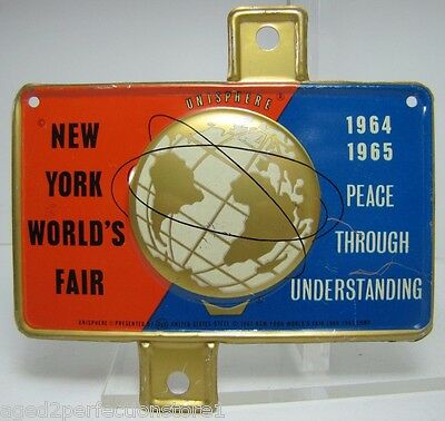 1964-65 New York World's Fair Unisphere License Plate Topper htf NYWF raised adv