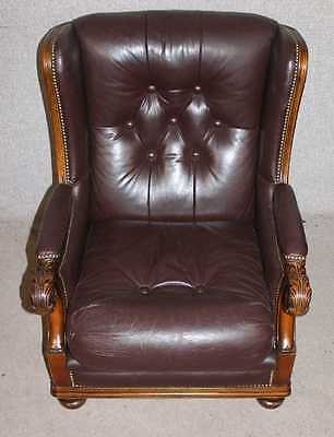 Quality Handsome Conker Brown Leather Armchair with Carved solid Frame.