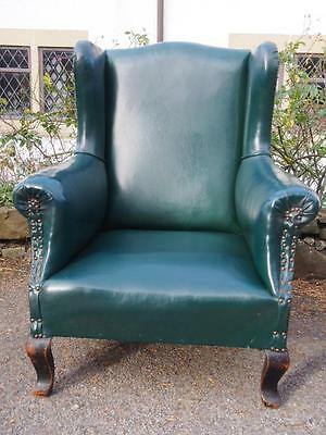 A Victorian Wingback Fireside Armchair in Green Leatherette with Studded Detail