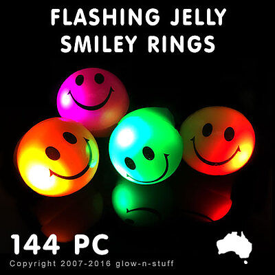144x FLASHING LED RINGS JELLY SMILEY GLOW DARK FINGER RING LIGHT PARTY FAVOURS