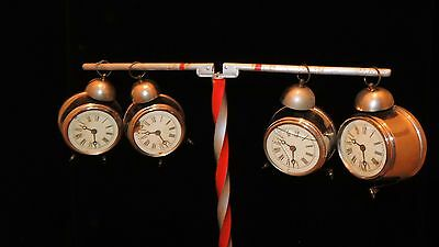 1930's & 40's: STAND &  group of 7 nested clocks.