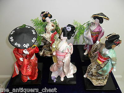 "Dancing Geishas dolls ceramic and hand made attires, with flowers around 12""[5]"
