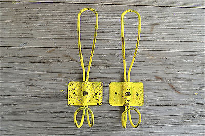 A pair of vintage French cafe style yellow steel coathooks coat hook hanger