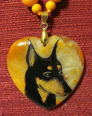 Standard Manchester Terrier hand paintedd on heart shaped pendant/bead/necklace