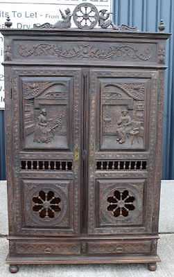 Highly Carved 2 Door Breton dark Oak Wardrobe all hanging with Drawers.1900's