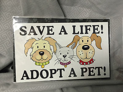2 car refrigerator magnets adopt a pet cat and dog and paws