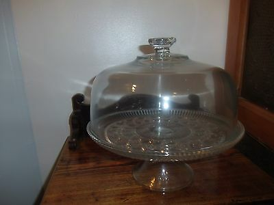 glass cake dish on pedistal with glass lid very heavy