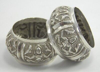 Antique pair of Indian silver serviette napkin rings embossed figural decoration