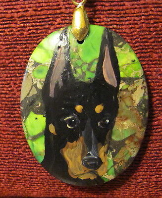 Doberman Pinscher hand painted on oval pendant/bead/necklace