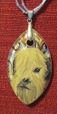 Soft Coated Wheaten Terrier hand painted on a marquise Glass pendant/bead/neckla