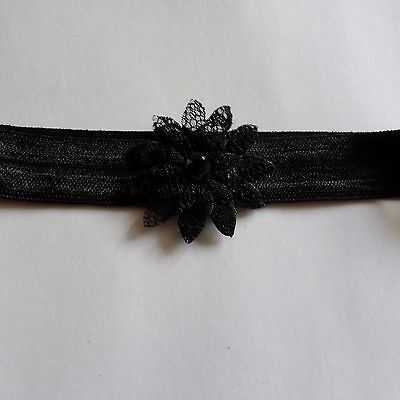 baby headband one size black with a black lace flower
