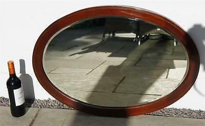 Early 20th c inlaid Mahogany, oval,  bevel edged wall  mirror 56 x 80 cm  VGC