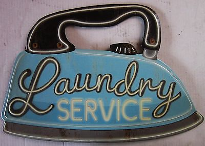 Laundry Service Embossed Metal Sign