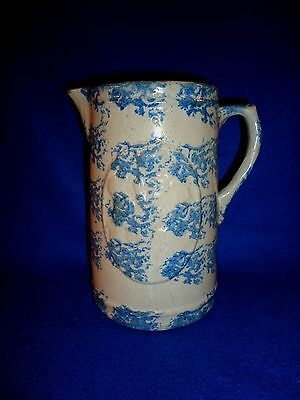 Blue and White Stoneware Spongeware Pitcher, Girl and Dog in Medallion Pattern