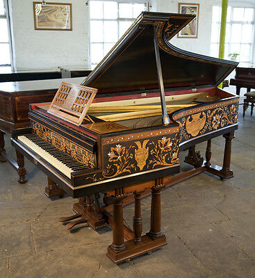 Stunning, 1891, Broadwood grand piano with an intricately inlaid case.