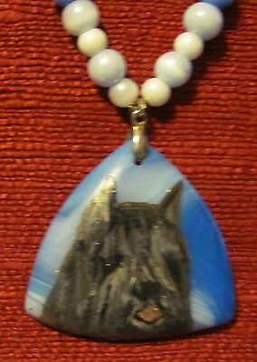 Bouvier des Flandres hand painted on a triangular, blue  Onyx Agate pendant/bead