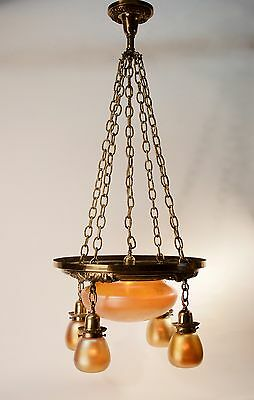 Early 1900's cast & stamped brass five light fixture with signed Quezal shades