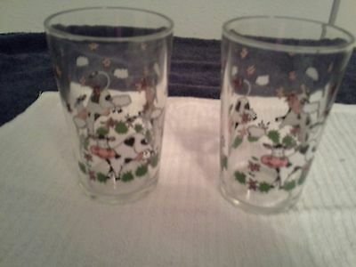Set of Two 6 oz. Juice Glasses With Cow Designs.