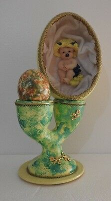 Handmade Baby in Painted Emu Egg with Decorative Chicken Egg in a Twin Egg Cup.