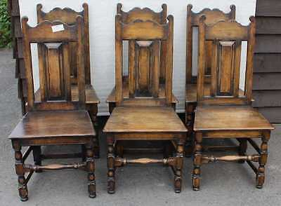 Set 6 Carved Oak High Back Dining Chairs Oak seats, cross stretchers. 1940's