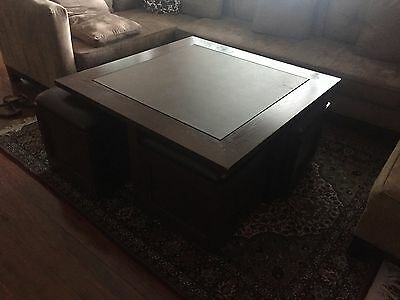 Coffee table, including 4 retractable stools