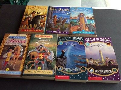 Seven Tamora Pierce Paperback Books  See Photos for Titles and Details