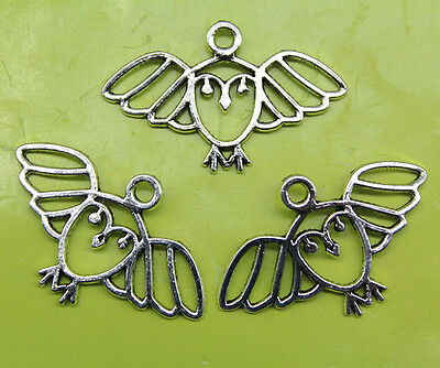 Free shipping Hollow out of the bird alloy charms pendants 18*29mm
