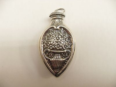 silver antique looking perfume bottle with funnel pendant