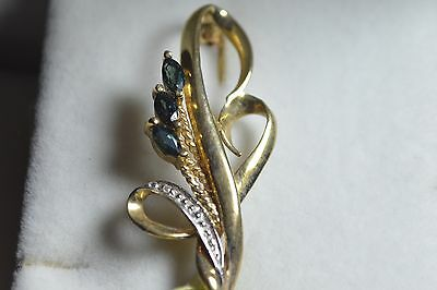 BN 9ct gold brooch with illusion set diamond and sapphires