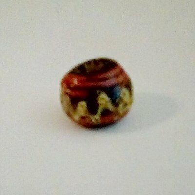 A Late Roman Trail Decorated Glass Bead, circa 4th Century AD