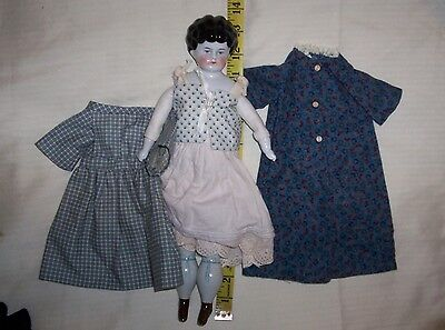 china head doll with clothes