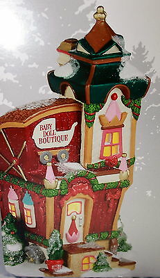Dept. 56 North Pole Village Series TOYLAND BABY DOLL BOUTIQUE - LIT BUILDING