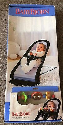 baby bjorn bouncer with wooden activity toy