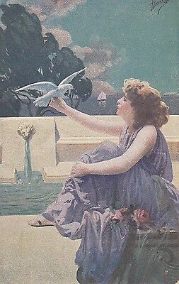 CK62. Vintage Postcard. A lady sitting by a pool holding a dove.