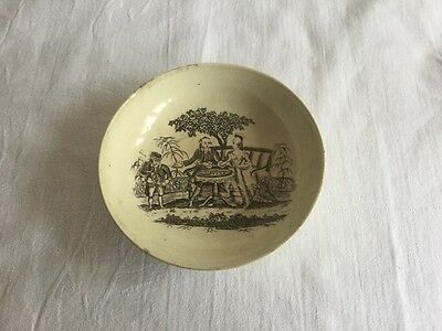 Pottery bowl with pattern showing historic figures taking tea in the garden