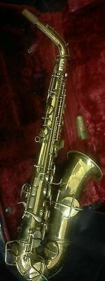 C.G.Conn Alto SaxophoneGold plated  circa 1920s. Mother of pearl inlay.