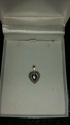 9ct gold pendant with black stone