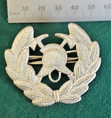 A South African Military Fire Brigade metal cap badge, Officers Issue. pre 1995