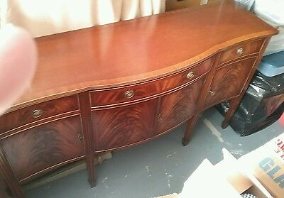 Bevan funnell Stunningexceptional  condition flame mahogany serpentine sideboard