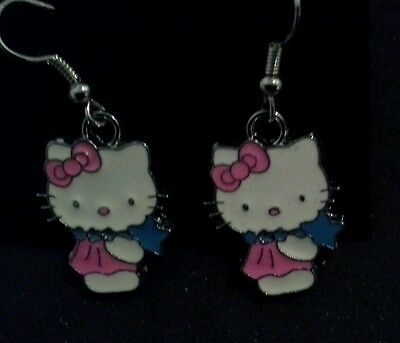 Hello Kitty earrings with pink bow and dress & blue necklace & star