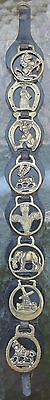 Horse brasses on leather 8 individual about 19 inches by 2inches wide  England