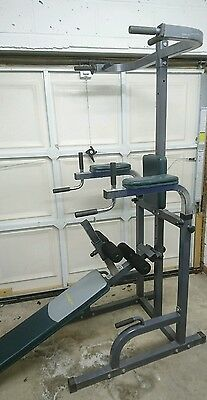 Dip station with chin up and adjustable sit up bench