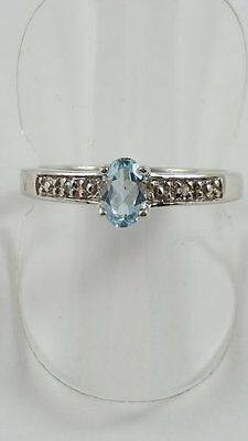 Silver Blue Topaz Ring With Diamonds Size O