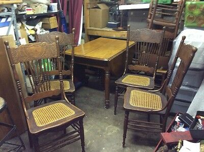 Antique table and chairs.  100 yrs + old.