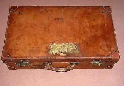 Beautiful old tan leather sutcase with brass fittings and nice label