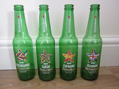 Heineken bottles x 4, with different country names (empty), 33 cl